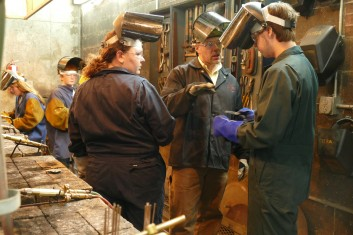 Tom Rogers, center, explains safety and procedure during is Welding I class at T.F. Riggs High School in Pierre.